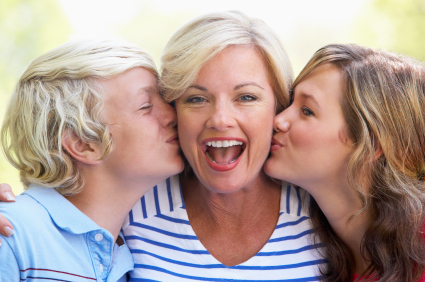 Woman Being Kissed By Her Teenage Children